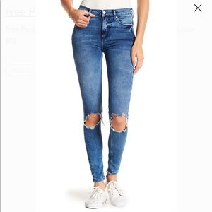 Busted knee high-waisted skinny jeans
